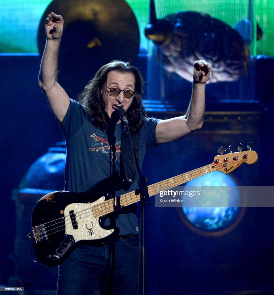Inductee <a gi-track='captionPersonalityLinkClicked' href=/galleries/search?phrase=Geddy+Lee&family=editorial&specificpeople=212809 ng-click='$event.stopPropagation()'>Geddy Lee</a> of Rush performs onstage at the 28th Annual Rock and Roll Hall of Fame Induction Ceremony at Nokia Theatre L.A. Live on April 18, 2013 in Los Angeles, California.
