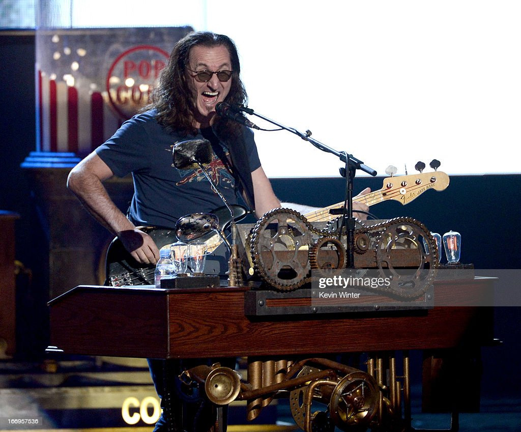 Inductee Geddy Lee of Rush performs onstage at the 28th Annual Rock and Roll Hall of Fame Induction Ceremony at Nokia Theatre L.A. Live on April 18, 2013 in Los Angeles, California.