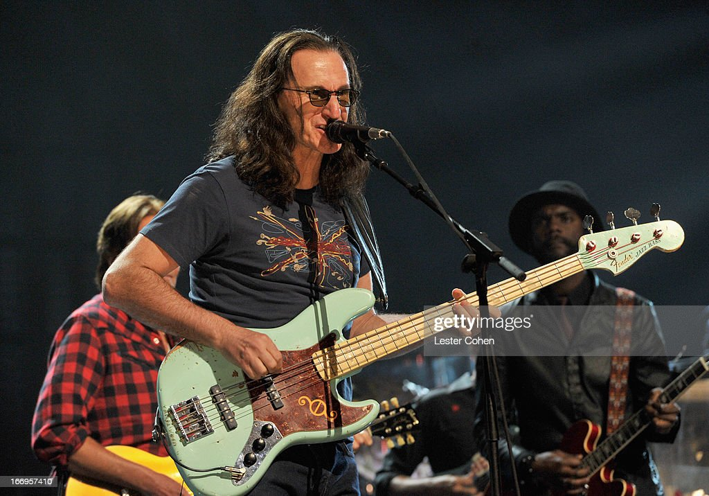Inductee <a gi-track='captionPersonalityLinkClicked' href=/galleries/search?phrase=Geddy+Lee&family=editorial&specificpeople=212809 ng-click='$event.stopPropagation()'>Geddy Lee</a> of Rush performs onstage during the 28th Annual Rock and Roll Hall of Fame Induction Ceremony at Nokia Theatre L.A. Live on April 18, 2013 in Los Angeles, California.