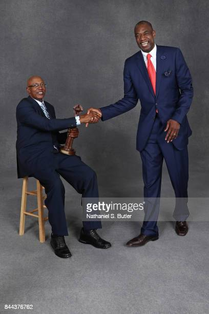 Inductee George McGinnis and Dikembe Mutombo shake hands pose for a portrait prior to the 2017 Basketball Hall of Fame Enshrinement Ceremony on...