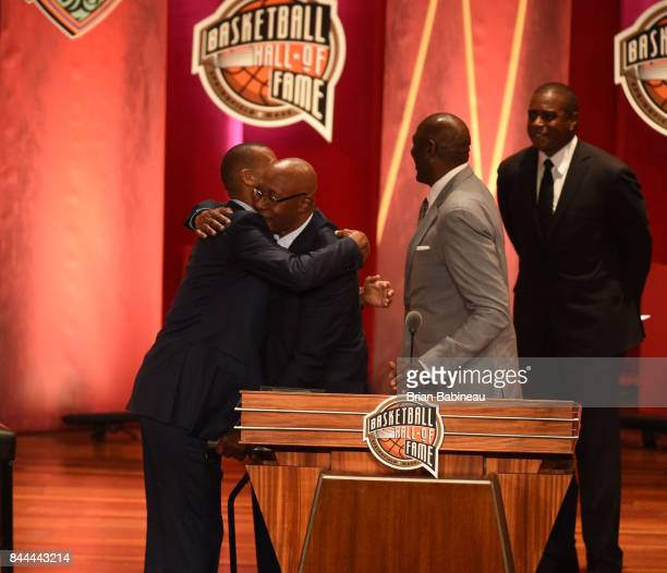 Inductee George McGinnis hugs Reggie Miller during the 2017 Basketball Hall of Fame Enshrinement Ceremony on September 8 2017 at the Naismith...