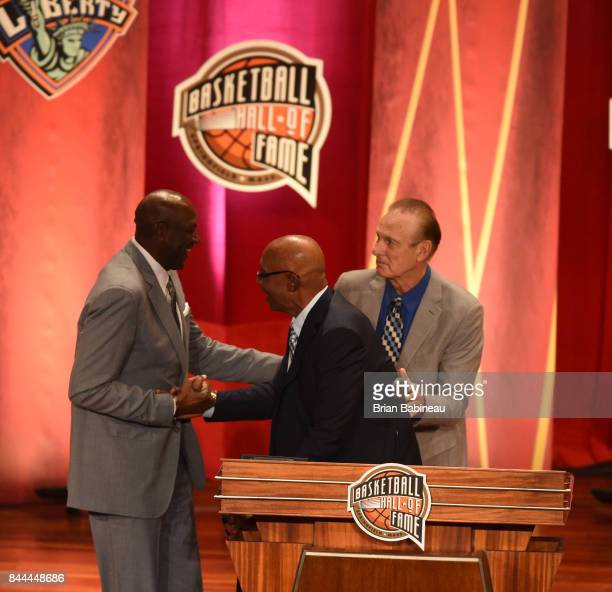 Inductee George McGinnis hugs Spencer Haywood during the 2017 Basketball Hall of Fame Enshrinement Ceremony on September 8 2017 at the Naismith...