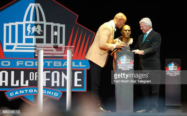 Inductee Jason Taylor leaning to kiss his bronze bust was introduced by his former coach Jimmy Johnson The 2017 NFL Hall of Fame class including...