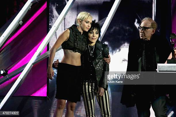 Inductee Joan Jett of Joan Jett and the Blackhearts and Miley Cyrus pose onstage during the 30th Annual Rock And Roll Hall Of Fame Induction Ceremony...