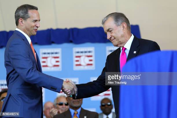 Inductee John Schuerholz shakes hands with National Baseball Hall of Fame and Museum President Jeff Idelson during the 2017 Hall of Fame Induction...