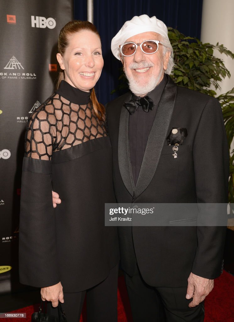 Inductee <a gi-track='captionPersonalityLinkClicked' href=/galleries/search?phrase=Lou+Adler+-+Record+Producer&family=editorial&specificpeople=228945 ng-click='$event.stopPropagation()'>Lou Adler</a> (R) and actress Page Hannah arrive at the 28th Annual Rock and Roll Hall of Fame Induction Ceremony at Nokia Theatre L.A. Live on April 18, 2013 in Los Angeles, California.