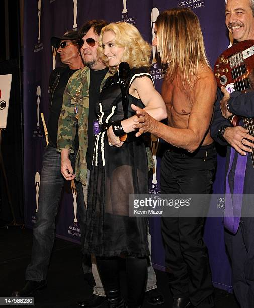 Inductee Madonna poses with Scott Asheton Ron Asheton Iggy Pop and Mike Watt of The Stooges in the press room at the 23rd Annual Rock and Roll Hall...