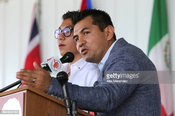 Inductee Marco Antonio Barrera is seen onstage with his interpreter during the International Boxing Hall of Fame induction Weekend of Champions event...