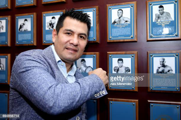 Inductee Marco Barrera poses beside his plaque inside the museum during the International Boxing Hall of Fame induction Weekend of Champions event on...