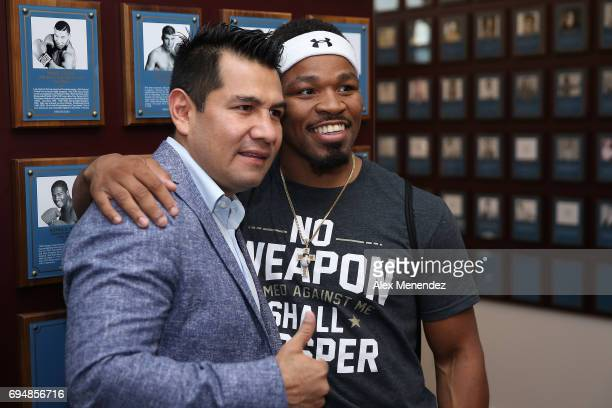 Inductee Marco Barrera poses with Shawn Porter inside the museum during the International Boxing Hall of Fame induction Weekend of Champions event on...