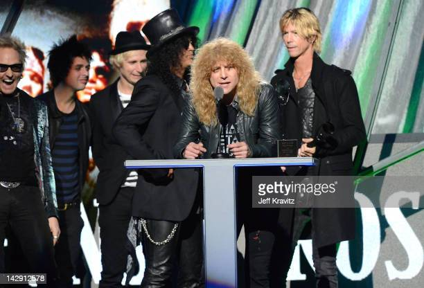 Inductee Matt Sorum Billie Joe Armstrong and Mike Dirnt of Green Day and Inductees Slash Steven Adler and Duff McKaganof Guns N' Roses on stage at...