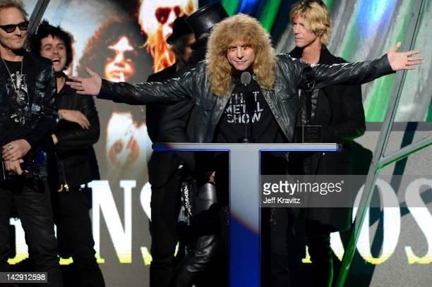 Inductee Matt Sorum Billie Joe Armstrong and Mike Dirnt of Green Day and Inductees Slash Steven Adler and Duff McKagan of Guns N' Roses on stage at...