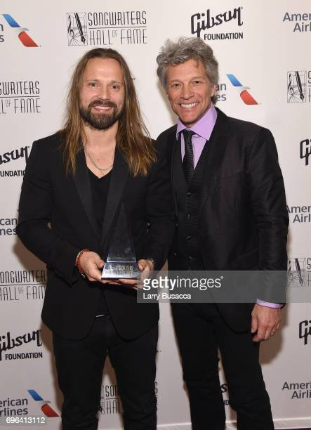 Inductee Max Martin poses backstage with Jon Bon Jovi at the Songwriters Hall Of Fame 48th Annual Induction and Awards at New York Marriott Marquis...