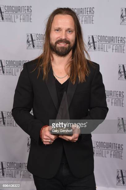 Inductee Max Martin poses with his award backstage at the Songwriters Hall Of Fame 48th Annual Induction and Awards at New York Marriott Marquis...