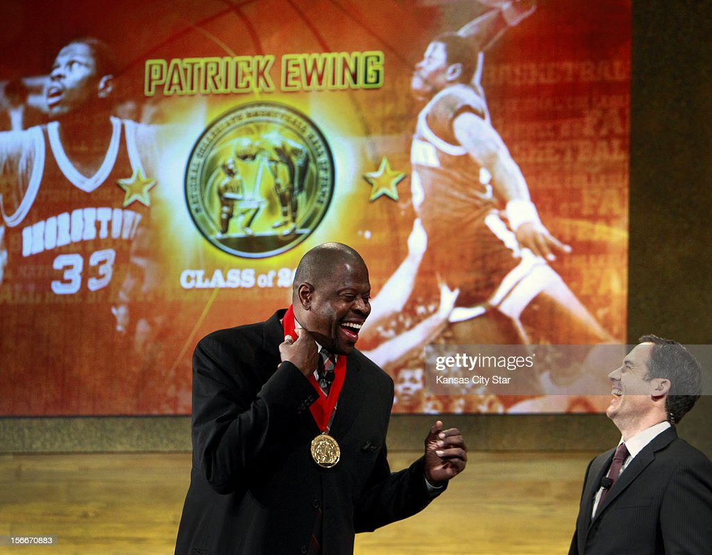 Inductee Patrick Ewing, left, and emcee Matt Winer share a laugh after the Georgetown great was presented his medal during the National Collegiate Basketball Hall of Fame on Sunday, November 18, 2012, in Kansas City, Missouri.