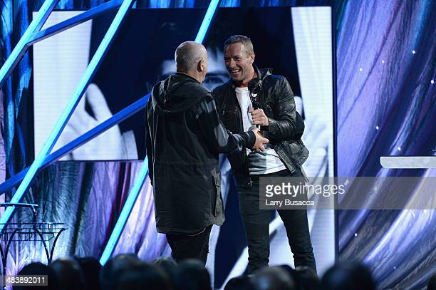Inductee Peter Gabriel and musician Chris Martin speak onstage at the 29th Annual Rock And Roll Hall Of Fame Induction Ceremony at Barclays Center of...