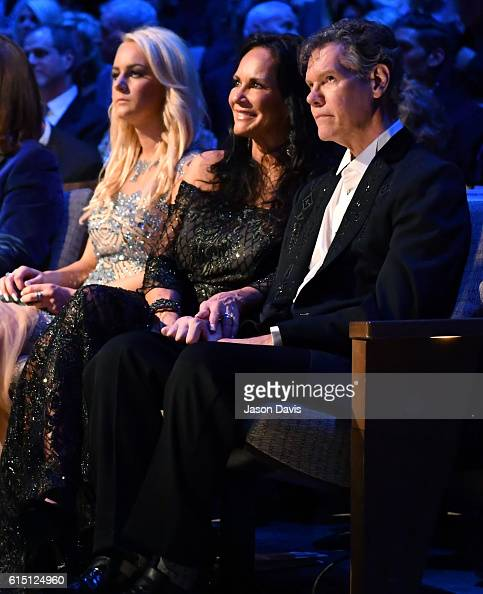 Inductee Randy Travis and wife Mary Davis watch performances during the 2016 Medallion Ceremony at Country Music Hall of Fame and Museum on October...