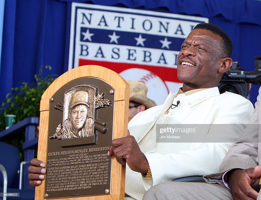 2009 inductee Rickey Henderson holds his plaque after his induction into the Baseball Hall of Fame at Clark Sports Center during the Baseball Hall of Fame induction ceremony on July 26, 2009 in Cooperstown, New York. Henderson is the all-time leader in stolen bases (1,406) and runs (2,295), a ten time All-Star, was the 1990 American League most valuable player and won two World Series titles.