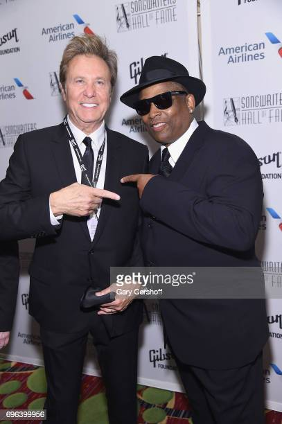 Inductee Robert Lamm and 2017 Inductee Terry Lewis pose backstage at the Songwriters Hall Of Fame 48th Annual Induction and Awards at New York...