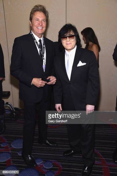 Inductee Robert Lamm and Executive Vice President of Creative Services for ASCAP John Titta pose backstage at the Songwriters Hall Of Fame 48th...