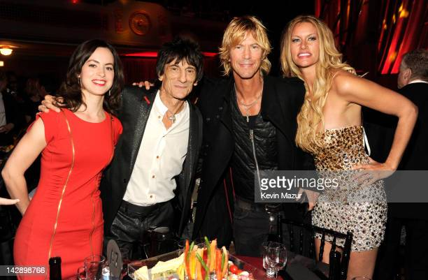 Inductee Ron Wood of Faces inductee Duff McKagan of Guns N' Roses and Susan Holmes attends the 27th Annual Rock And Roll Hall Of Fame Induction...