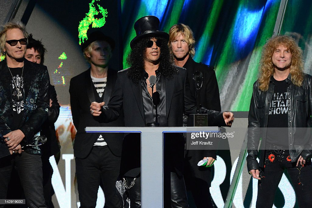 Inductee Slash of Guns N' Roses speaks as fellow inductees Matt Sorum Duff McKagan and Steven Adler look on at the 27th Annual Rock And Roll Hall Of...