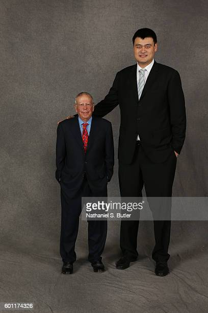 Inductee Yao Ming poses for a portrait with Houston Rockets owner Leslie Alexander prior to the 2016 Basketball Hall of Fame Enshrinement Ceremony on...