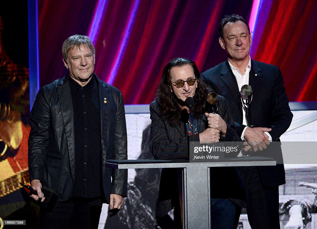 Inductees Alex Lifeson, Geddy Lee and Neil Peart of Rush speak on stage at the 28th Annual Rock and Roll Hall of Fame Induction Ceremony at Nokia Theatre L.A. Live on April 18, 2013 in Los Angeles, California.