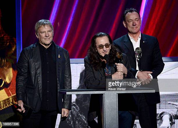 Inductees Alex Lifeson Geddy Lee and Neil Peart of Rush speak on stage at the 28th Annual Rock and Roll Hall of Fame Induction Ceremony at Nokia...
