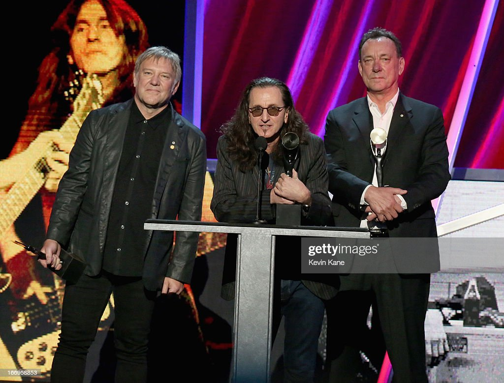 Inductees <a gi-track='captionPersonalityLinkClicked' href=/galleries/search?phrase=Alex+Lifeson&family=editorial&specificpeople=228149 ng-click='$event.stopPropagation()'>Alex Lifeson</a>, <a gi-track='captionPersonalityLinkClicked' href=/galleries/search?phrase=Geddy+Lee&family=editorial&specificpeople=212809 ng-click='$event.stopPropagation()'>Geddy Lee</a> and <a gi-track='captionPersonalityLinkClicked' href=/galleries/search?phrase=Neil+Peart&family=editorial&specificpeople=2133163 ng-click='$event.stopPropagation()'>Neil Peart</a> of Rush speak onstage during the 28th Annual Rock and Roll Hall of Fame Induction Ceremony at Nokia Theatre L.A. Live on April 18, 2013 in Los Angeles, California.