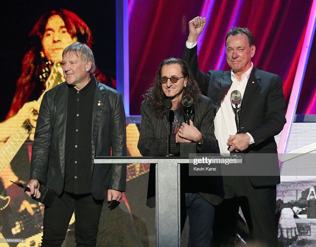 Inductees Alex Lifeson, Geddy Lee and Neil Peart of Rush speak onstage during the 28th Annual Rock and Roll Hall of Fame Induction Ceremony at Nokia Theatre L.A. Live on April 18, 2013 in Los Angeles, California.