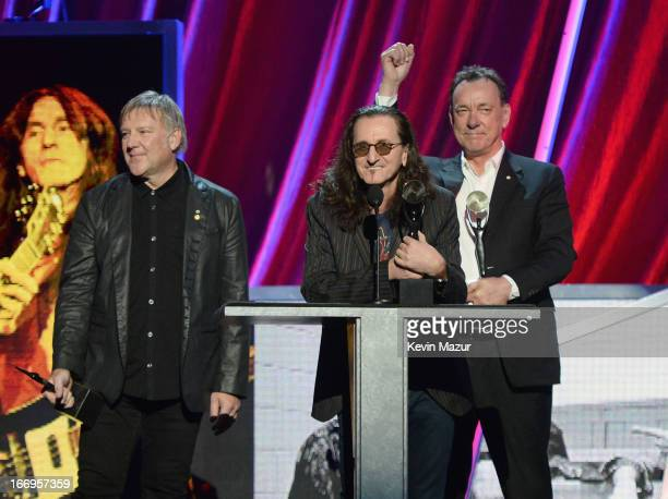 Inductees Alex Lifeson Geddy Lee and Neil Peart speak onstage during the 28th Annual Rock and Roll Hall of Fame Induction Ceremony at Nokia Theatre...