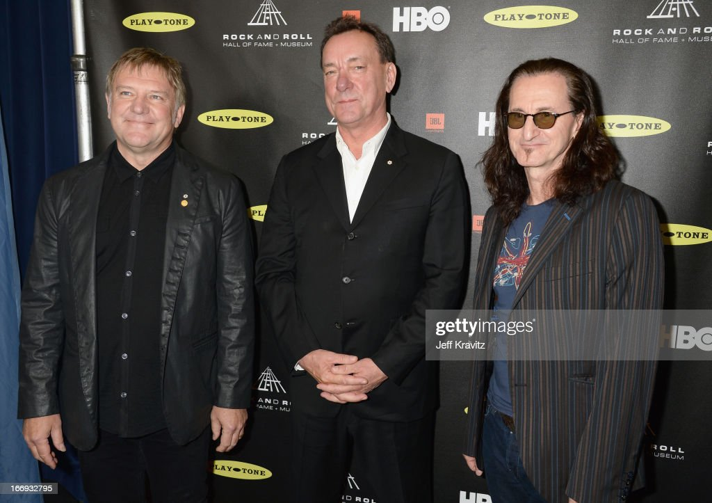 Inductees <a gi-track='captionPersonalityLinkClicked' href=/galleries/search?phrase=Alex+Lifeson&family=editorial&specificpeople=228149 ng-click='$event.stopPropagation()'>Alex Lifeson</a>, <a gi-track='captionPersonalityLinkClicked' href=/galleries/search?phrase=Neil+Peart&family=editorial&specificpeople=2133163 ng-click='$event.stopPropagation()'>Neil Peart</a> and <a gi-track='captionPersonalityLinkClicked' href=/galleries/search?phrase=Geddy+Lee&family=editorial&specificpeople=212809 ng-click='$event.stopPropagation()'>Geddy Lee</a> of Rush arrive at the 28th Annual Rock and Roll Hall of Fame Induction Ceremony at Nokia Theatre L.A. Live on April 18, 2013 in Los Angeles, California.