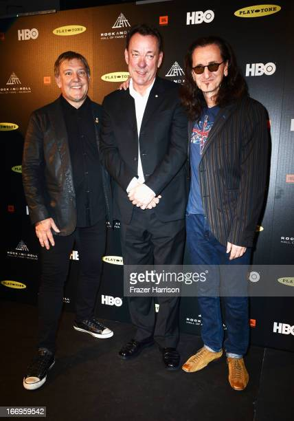 Inductees Alex Lifeson Neil Peart and Geddy Lee of Rush pose in the press room at the 28th Annual Rock and Roll Hall of Fame Induction Ceremony at...
