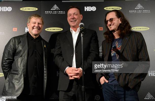 Inductees Alex Lifeson Neil Peart and Geddy Lee pose in the press room at the 28th Annual Rock and Roll Hall of Fame Induction Ceremony at Nokia...