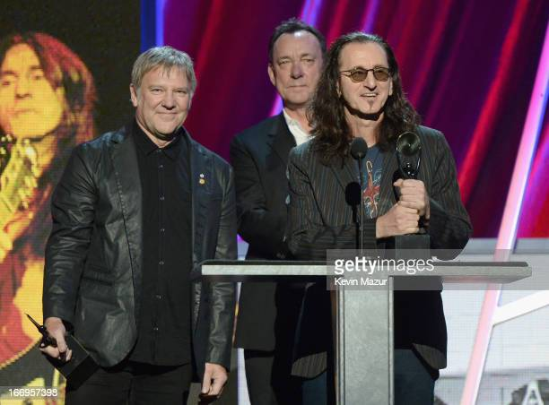 Inductees Alex Lifeson Neil Peart and Geddy Lee speak onstage during the 28th Annual Rock and Roll Hall of Fame Induction Ceremony at Nokia Theatre...