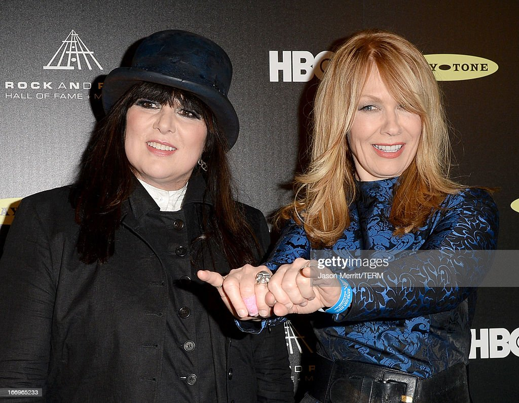 Inductees Ann Wilson (L) and Nancy Wilson of Heart pose in the press room at the 28th Annual Rock and Roll Hall of Fame Induction Ceremony at Nokia Theatre L.A. Live on April 18, 2013 in Los Angeles, California.