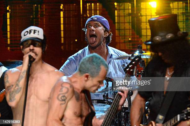 Inductees Anthony Kiedis Flea Chad Smith and Slash perform on stage at the 27th Annual Rock And Roll Hall Of Fame Induction Ceremony at Public Hall...