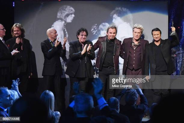 Inductees Aynsley Dunbar Gregg Rolie Steve Smith Steve Perry Neal Schon and Jonathan Cain of Journey accept an award onstage at the 32nd Annual Rock...