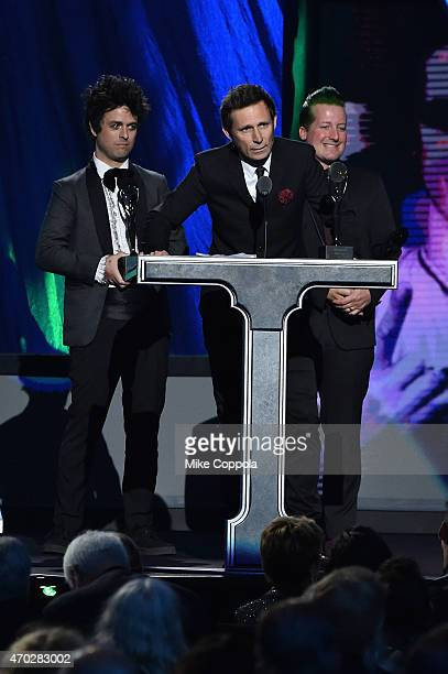 Inductees Billie Joe Armstrong Mike Dirnt and Tre Cool of Green Day speak onstage during the 30th Annual Rock And Roll Hall Of Fame Induction...