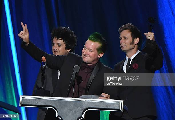 Inductees Billie Joe Armstrong Tre Cool and Mike Dirnt of Green Day speak onstage during the 30th Annual Rock And Roll Hall Of Fame Induction...
