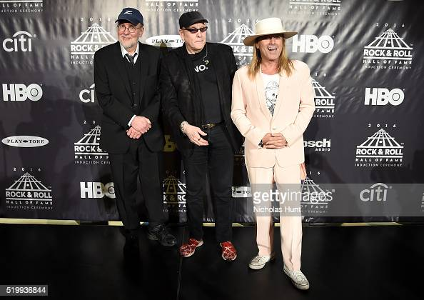 Inductees Bun E Carlos Rick Nielsen and Robin Zander of Cheap Trick pose onstage in the press room at the 31st Annual Rock And Roll Hall Of Fame...