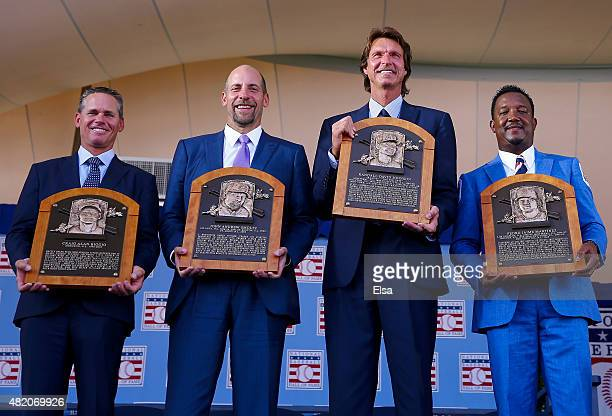 Inductees Craig BiggioJohn SmoltzRandy Johnson and Pedro Martinez pose with their plaques after the Induction Ceremony at National Baseball Hall of...