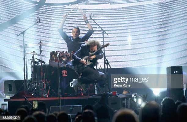 Inductees Eddie Vedder and Matt Cameron of Pearl Jam perform onstage at the 32nd Annual Rock Roll Hall Of Fame Induction Ceremony at Barclays Center...