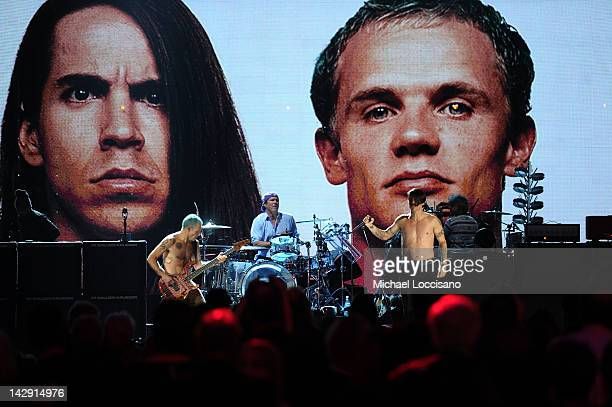Inductees Flea Chad Smith and Anthony Kiedis of The Red Hot Chili Peppers perform onstage during the 27th Annual Rock And Roll Hall of Fame Induction...