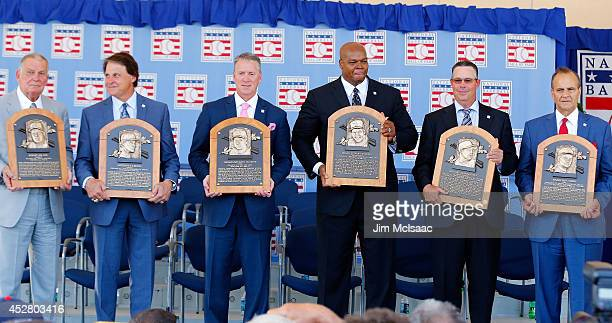 Inductees from left Bobby Cox Tony La Russa Tom Glavine Frank Thomas Greg Maddux and Joe Torre pose with their plaques at Clark Sports Center during...
