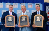 Inductees from left Tom Glavine Bobby Cox and Greg Maddux pose with their plaques at Clark Sports Center during the Baseball Hall of Fame induction...