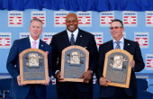 Inductees from left Tom Glavine Frank Thomas and Greg Maddux pose with their plaques at Clark Sports Center during the Baseball Hall of Fame...