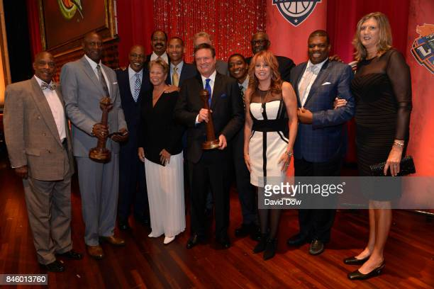 Inductees George McGinnis Bill Self pose for a photo with Artis Gilmore Ann Meyers Reggie Miller Larry Bird Isiah Thomas Nancy Lieberman and Bob...