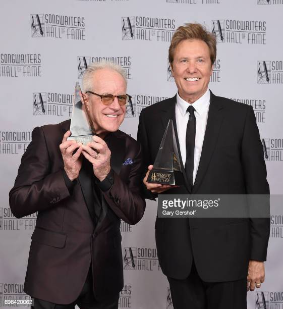 Inductees James Pankow and Robert Lamm pose with their awards backstage at the Songwriters Hall Of Fame 48th Annual Induction and Awards at New York...